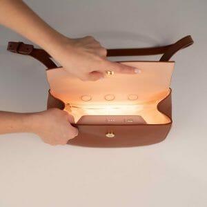 Crossbody bag with light inside